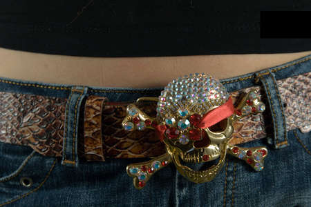 belly bandage:  Belt with a skull on a waist Stock Photo