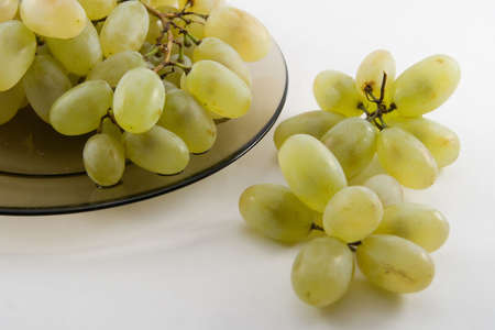 Green grapes on a plate photo