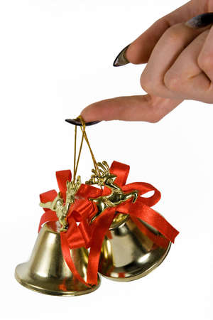 Two handbells hanging on a finger. White background. photo