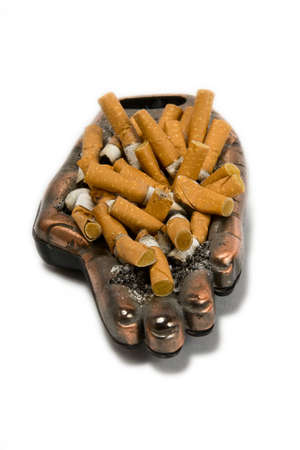 Ashtray with many cigarette on a white background photo