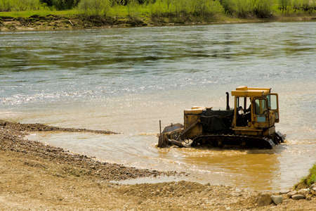 trencher: Tractor working in water Stock Photo