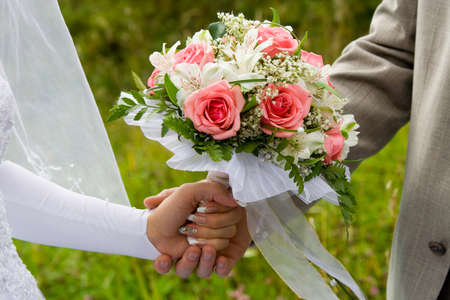 Wedding bouquet in hands of the groom and the bride Stock Photo - 1440956