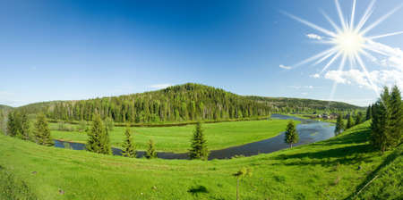Summer landscape. Village on the river. Panorama. photo