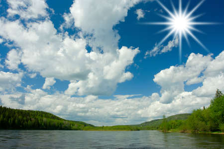 Summer landscape. Clouds above the river. photo