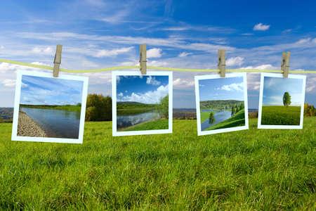 Landscape photographs hanging on a clothesline photo