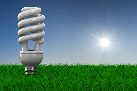 energy saving bulb on grass. 3D image photo