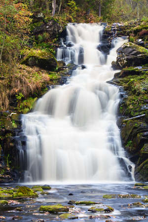 mountain waterfall. fast stream water. autumn landscape photo