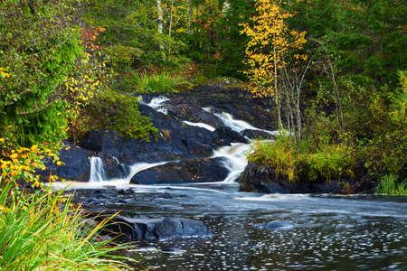mountain waterfall. fast stream water. autumn landscape Stock Photo - 8768325