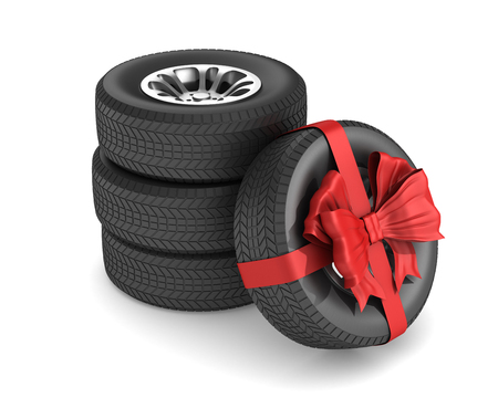 tire with red bow on white background. Isolated 3D illustration Reklamní fotografie