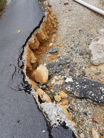 Road erosion by the seaside.
