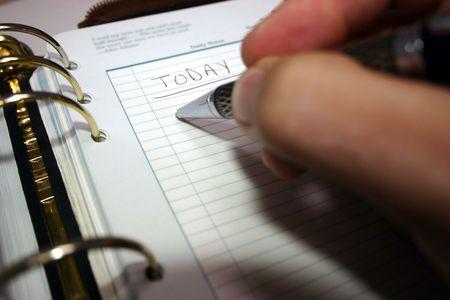 Writing in daily organizer Archivio Fotografico