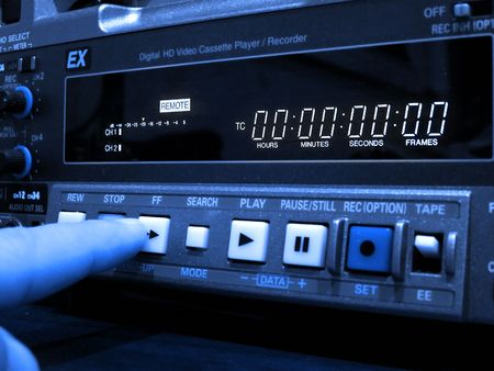 Finger pushing button on professional vcr photo