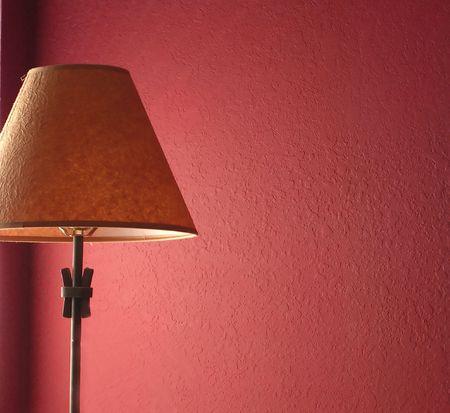 赤い壁とランプ 写真素材