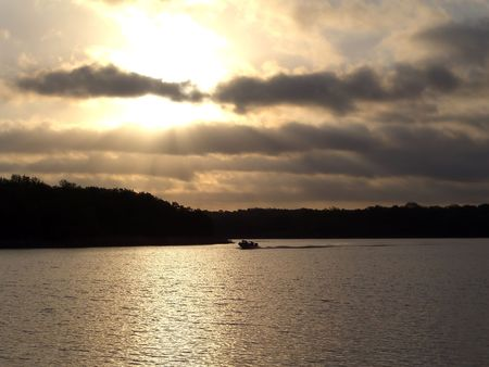 Boat on lake during sunset Archivio Fotografico