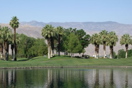 springs: Golf Resort in Palm Springs with Mountains in background Stock Photo