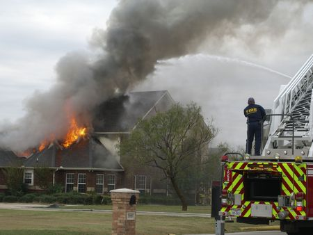 engine fire: Firefighters responding to house fire