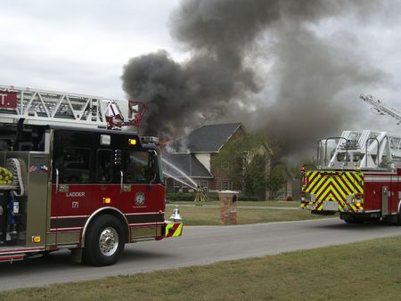 home destruction: Fighting a house fire