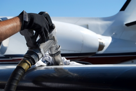 fuel economy: Fuel nozzle filling up aircraft