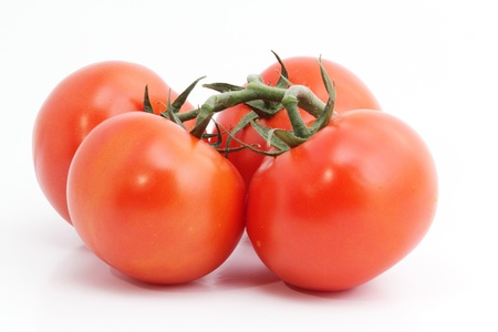 Four red tomatos on white backround
