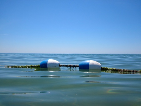 buoy rope barrier on the water with floats