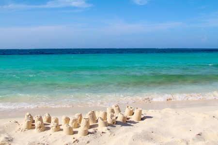 Sandcastles on the beach, sea and sky background