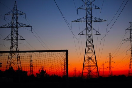 The sunset view of soccer net under the power line Stock Photo