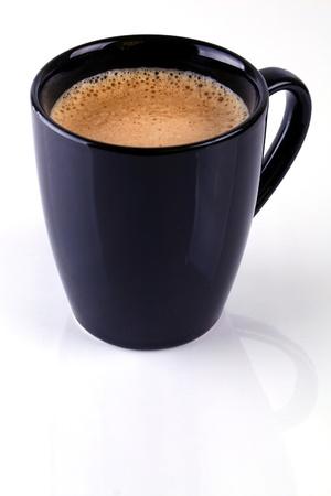 expresso: Black mug with fresh brewed coffee