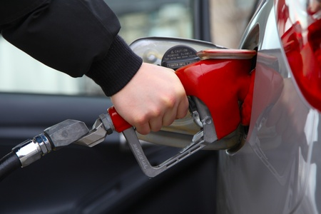 Gas pump refilling automobile fuel  Shallow focus