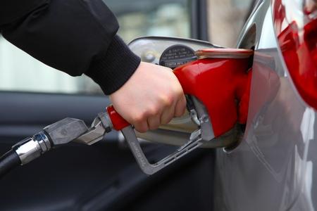 Gas pump refilling automobile fuel  Shallow focus