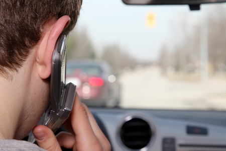 Young driver talking on the phone while driving