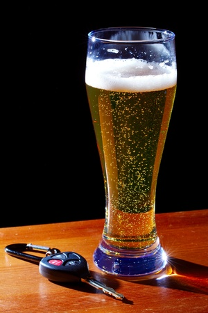 Glass of light beer and car key Banco de Imagens