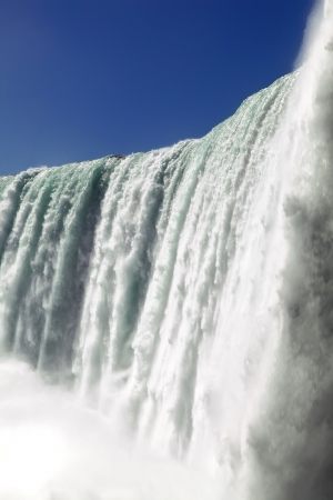 The view of the waterfall on the blue sky background. Niagara Falls, Ontario Reklamní fotografie