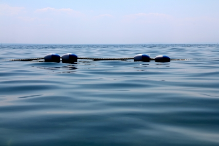 barrier: buoy floats rope barrier on the water  Lake Erie, Crystall Beach, Ontario Stock Photo