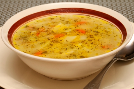 The bowl of fresh chicken soup, shallow focus
