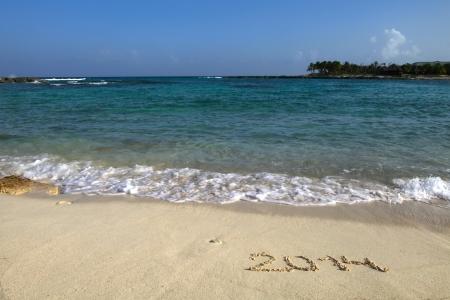 Inscription 2014 on a beach sand  Riviera Maya, Mexico