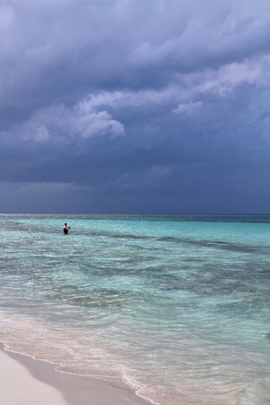 Lonely fisherman on the sea and sky background. Cayo Coco