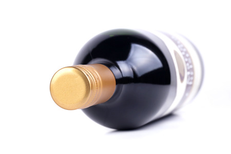 Red wine bottle isolated on the white background, very shallow focus