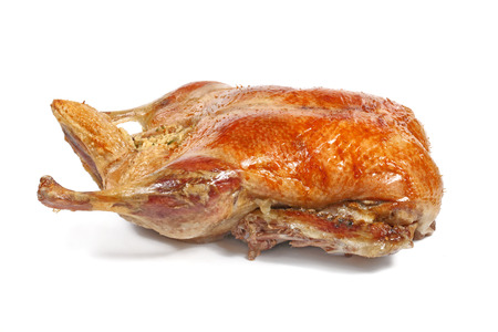 Roast duck isolated on white background, shallow focus Stock Photo