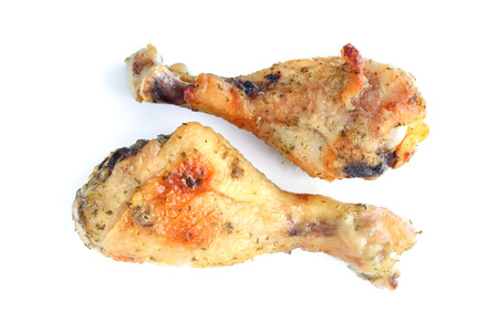 Chicken drumsticks isolated on white, shallow focus