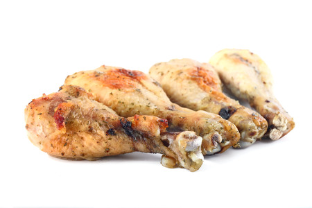 shallow  focus: Chicken drumsticks isolated on white, shallow focus