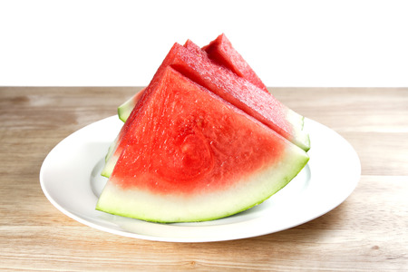Watermelon slices on the white plate, shallow focus