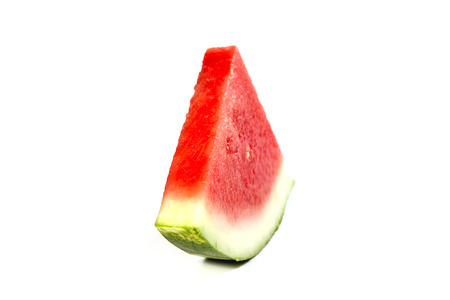 Watermelon slice on the white background, shallow focus
