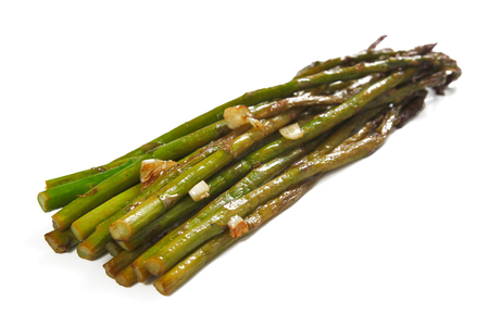 Roasted asparagus with garlic, isolated, shallow focus