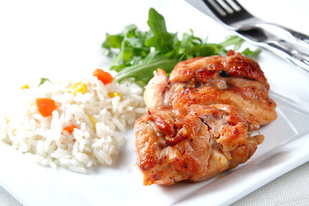 Roasted chicken snack on white background, shallow focus