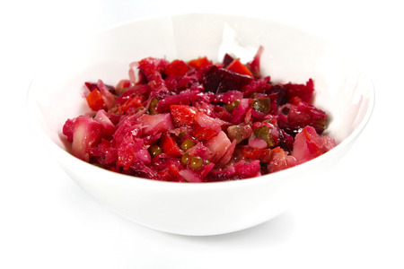 Russian beet winter salad on white background, shallow focus Stock Photo