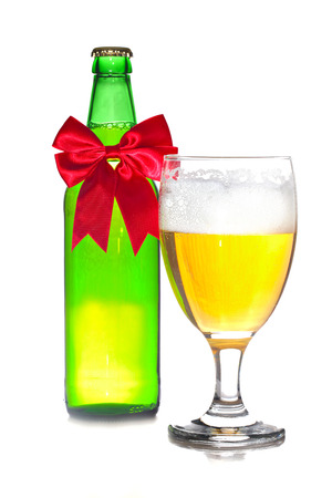 Beer with Christmas ribbon isolated on white background, shallow focus Stock Photo