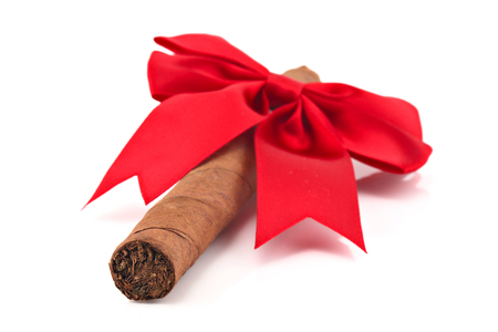Cigar with christmas ribbon isolated on white, shallow focus Stock Photo