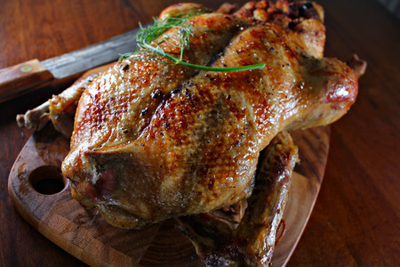 Roast duck, on the carving board, shallow focus Stock Photo