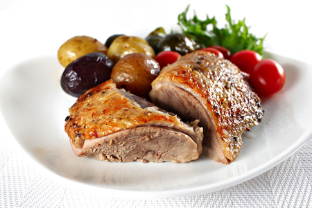 Roast duck, served with vegetables, shallow focus