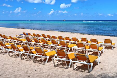 Sunbeds on the tropical beach on the sand and sea background Stock fotó